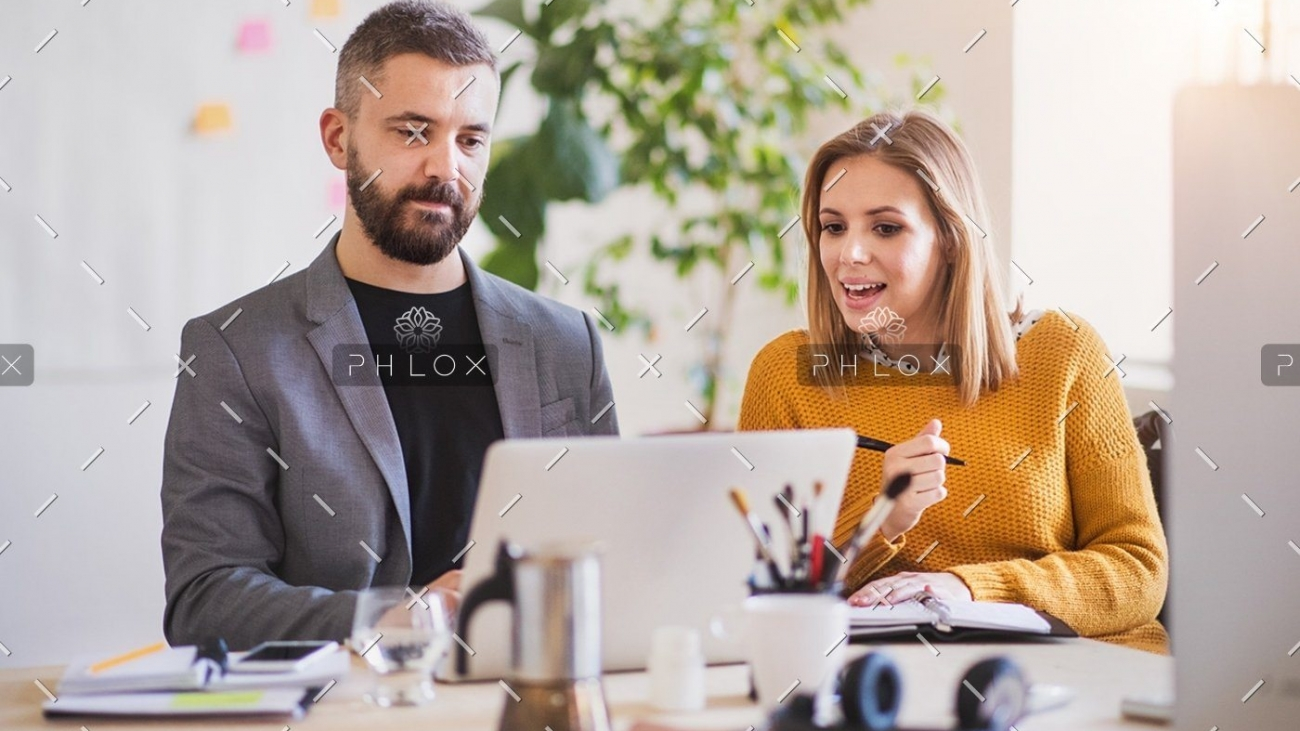 demo-attachment-1150-two-business-people-with-wheelchair-in-the-office-P7XLSBC